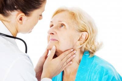 nurse examining elder woman